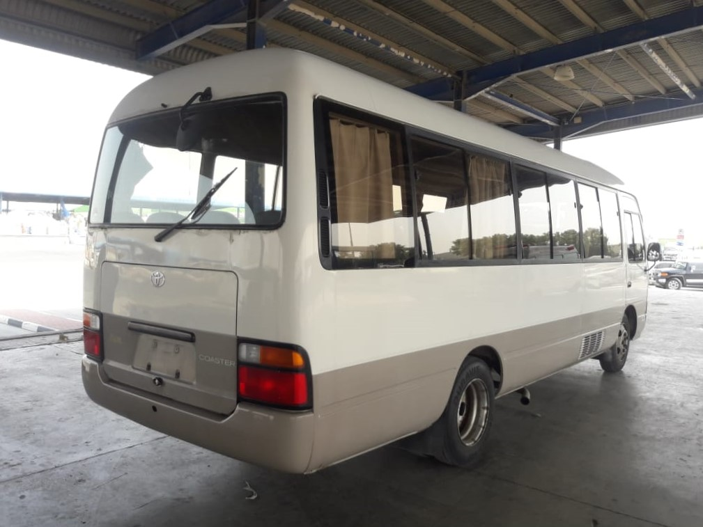 0380-TOYOTA COASTER 4.2 AT BUS WHITE BROWN